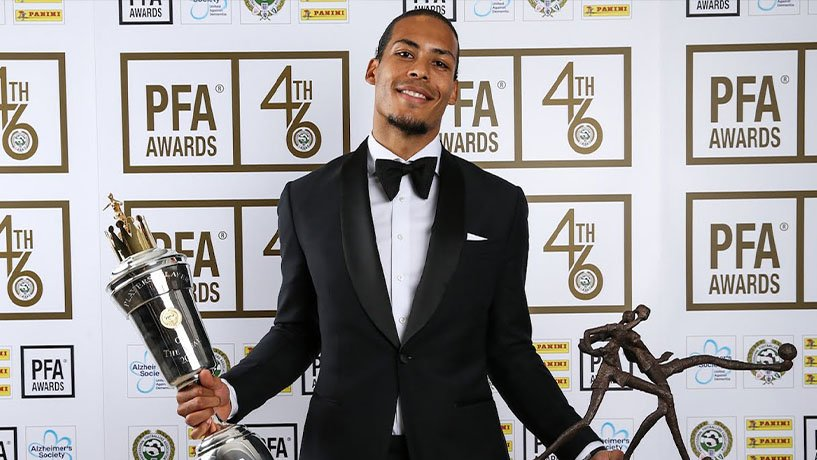 Van Dijk holding his cup at the Player of the Year ceremony