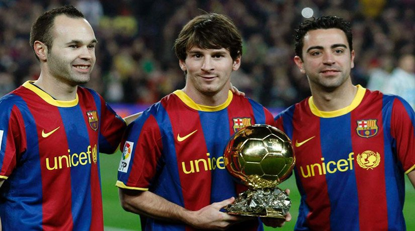 Lionel Messi with his teammates Xavi and Andrés Iniesta